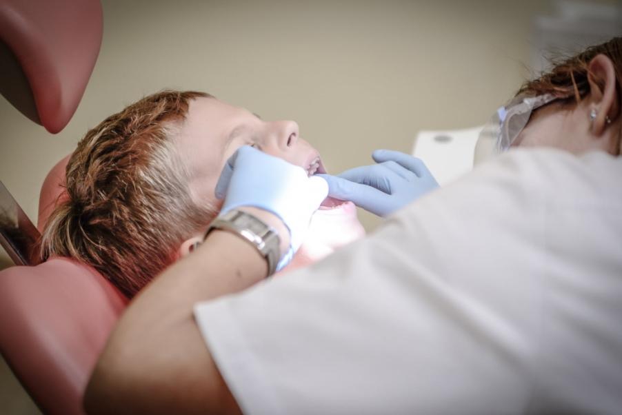 Child receiving dental exam